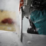 Ian Douglas-Jones chainsawing ice at the Legacy of the River Suite ©Rousseau Design & I-N-D-J