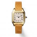 Santos wristwatch. Cartier Paris, 1915. Gold, sapphire, leather strap; 3.49 x 2.47 cm. Cartier Collection. Photo: Nick Welsh, Cartier Collection © Cartier