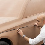 Exterior designer Nader Faghihzadeh working on the BMW 7 Series clay model