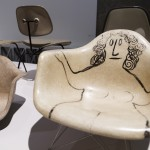 The World of Charles and Ray Eames, Installation view of LAR (Lounge Armchair Rod Base) with drawing by Saul Steinberg, c. 1950, Barbican Art Gallery, London 21 October 2015 – 14 February 2016 © Tristan Fewings/ Getty Images
