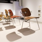 The World of Charles and Ray Eames, Installation view of moulded plywood furniture, Barbican Art Gallery, London 21 October 2015 – 14 February 2016 © Tristan Fewings/ Getty Images