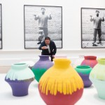 Ai Weiwei taking a photograph of his installation Coloured Vases, Royal Academy of Arts © Dave Parry