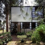 The World of Charles and Ray Eames. Eames House courtyard. Photo Timothy Street_Porter © Eames Office LLC