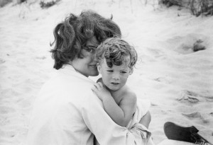 Jackie and Caroline on the beach in Hyannis Port in 1959 for the cover of Mark Shaw's book on John F. Kennedys, re-released in 2000. Copyright © Mark Shaw/mptvimages.com