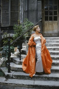 Courtyard Givenchy Rust Cape, 1955 – Givenchy dress and cape. Photographed in a Paris courtyard for the September 1955 issue of LIFE magazine © Mark Shaw / mptvimages.com