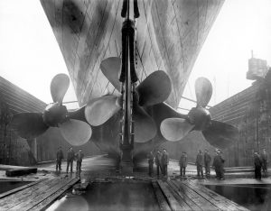 Vintage maritime history photo of the RMS Titanic's propellers as the mighty ship sits in dry dock © V&A Ocean Liners: Speed & Style