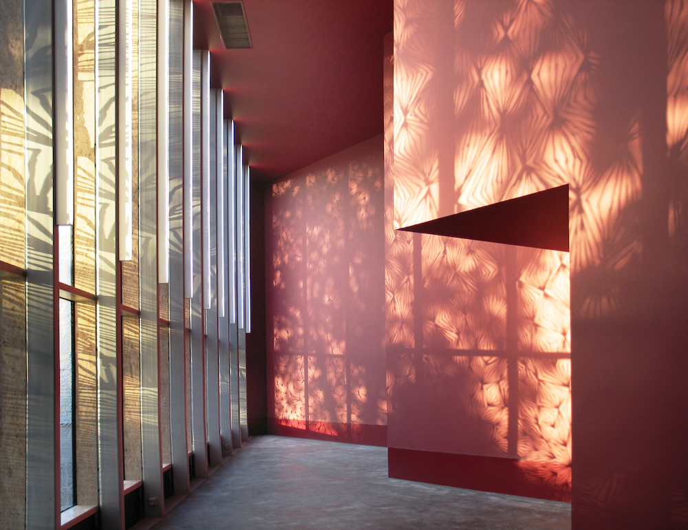 Stephen Lawrence Centre, London, UK, 2004-7, entrance foyer with projection of Chris Ofili window © Lyndon Douglas